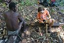 At the Third Lake, Katie cuts up some sugar cane while the owner of the machete watches tentatively.