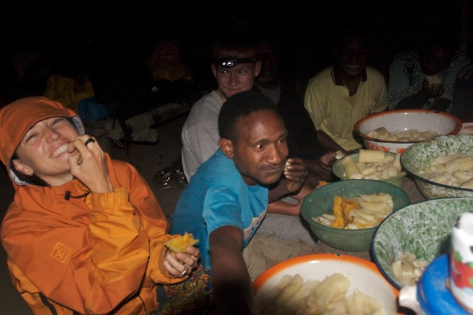 Eating the evening meal in O-village. Although the language barrier was felt between us and our guides for much of the trip, on some occasions like this one, exhaustion and the joy of eating brought us together. You can see the boiled cassava and sweet potato we were served. (What you can't see are the small minnows they served us ... whole.)