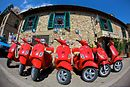 This lineup of red Vespas was for real. Sometimes we'd see a whole street lined only with Vespas (though they usually weren't matching like this).