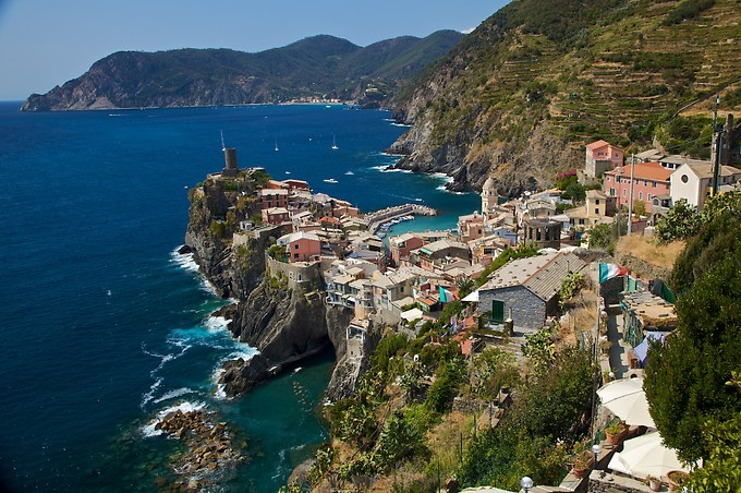 This was one of our favorite villages, Vernazza. It had charming towers and turrets, and a tunnel beneath the peninsula from the marina on the right of the peninsula to the cove on the left. We ended our first day here, with a nice cool swim and some down time at a cafe.