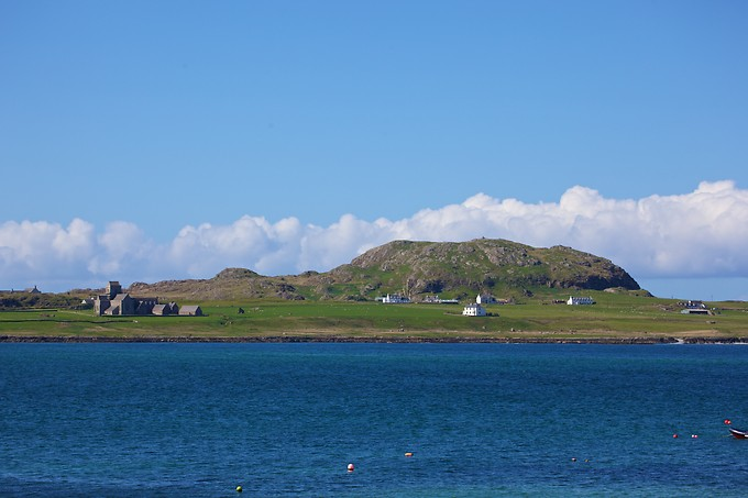 The island of Iona. It has been a centre of Scottish monasticism for 4 centuries. Part of the Inner Hebrides, Iona is one mile off the coast of Mull. It's only 1 mile wide and 3 miles long, with a population of 125.