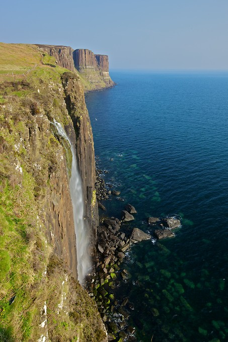 Mealt Waterfall in the foreground, with Kilt Rock in the background.
