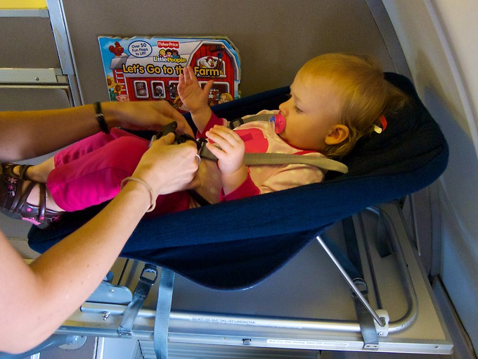 The nice cot provided by British Airways for Naomi to sleep in, strapped in.