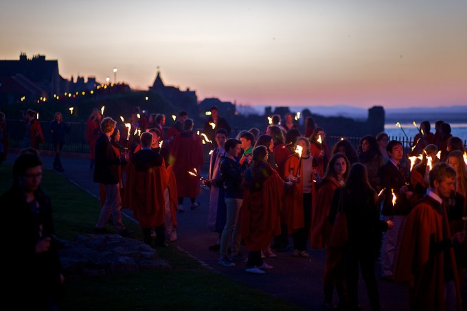For the ceremony, students carry torches, walk out to the water's edge, and several floating lanterns are released into the air.