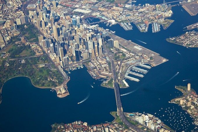 Our first glimpse of Sydney, from the air. You can see the Opera House on the left, just below the Royal Botanic Gardens, then the looming CBD (Central Business District) where all the high rises are, and the Harbour Bridge cutting across the bay. The 5 wharves jutting into the water between the CBD and the Opera House are Circular Quay (the main ferry landing). At the bottom of the picture, across the bridge from the CBD, is Kirribilli, our neighborhood.