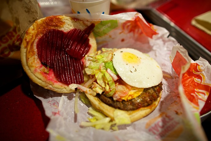An Aussie Burger is a burger with lettuce, tomato, sliced beets, a pineapple ring and a fried egg. It's actually quite good!