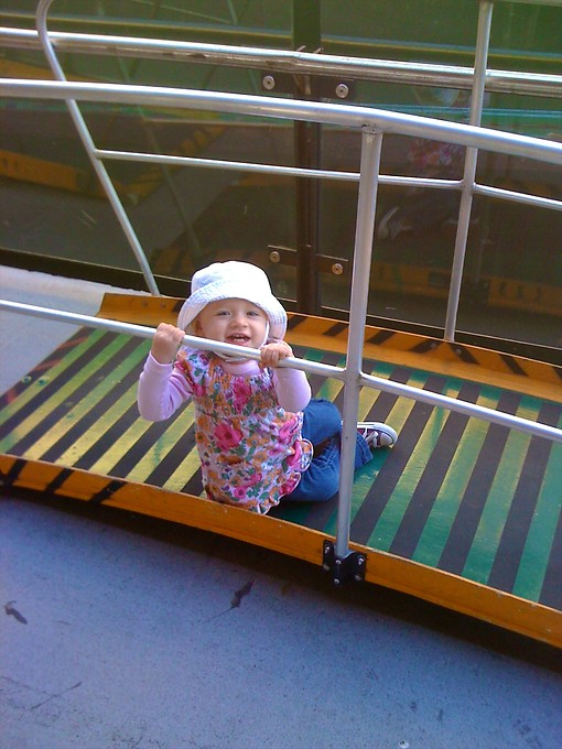 One of Naomi's favorite pasttimes is climbing on these portable ramps used for dis/embarking on the ferries.