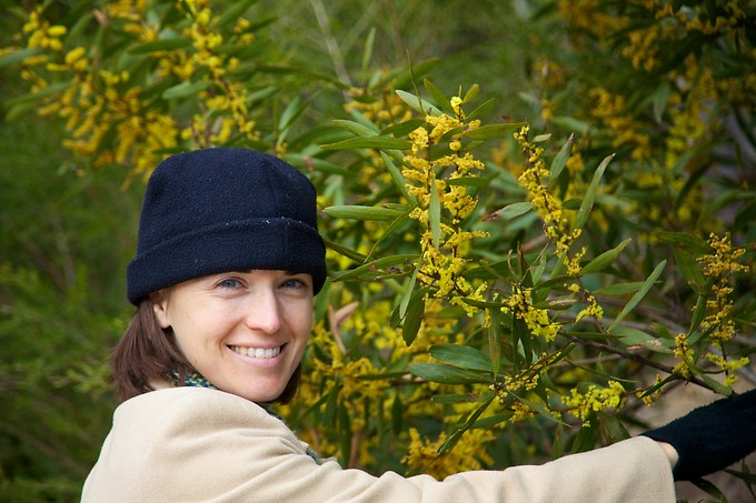Katie with the Australian national flower, wattle (acacia).